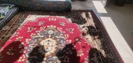 Carpet with beautiful print in maroon colour.