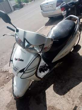 Honda active good condition white color brand new tyres , single owner