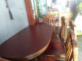 Dining table and chairs are made with wood