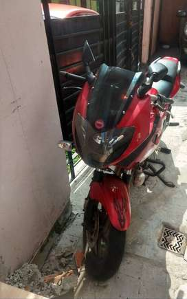 RED PULSAR 220F WITH SPORT'S EXHAUST HIGH PICKUP