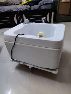 Pedicure tub, beauty chair and hair cutting chair.