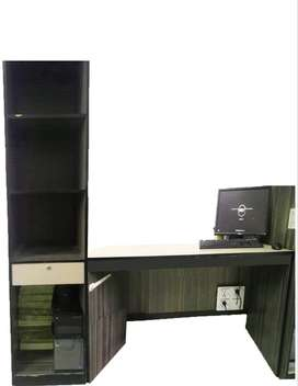 Office table and CPU and file cabinet with drawer.