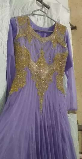 Girl maxi ... colour in purple and golden neck work ... length is 50 .