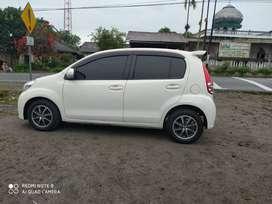 Jual Daihatsu Sirion Manual 1.3 cc 2014 Warna Putih