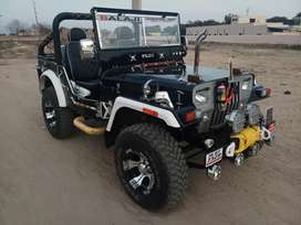 Modified open Willys Hunter jeeps