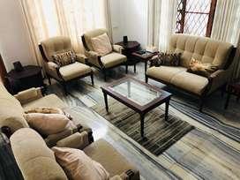 teakwood sofa set with beige cushion