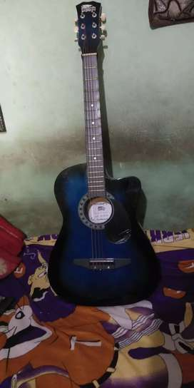 Less usd 38 inch guitar for with extra strings sell urgent