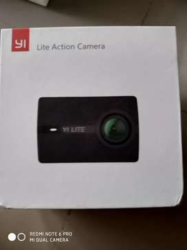 BRAND NEW YI LITE ACTION CAMERA WITH 1 YEAR WARRANTY