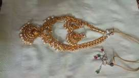 One gram gold not used (two sets )necklaces .low price.negiotable