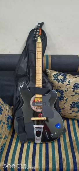 New guitar Hardly used semi electric guitar