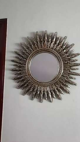 Sun shaped round mirror with wall hanging