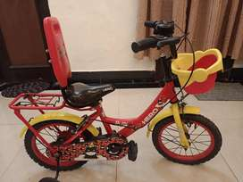 Kids cycle with side wheels in brilliant condition