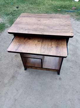 Wooden new unused study table available in dark brown color
