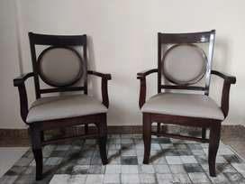 A set of wooden chair with arm rest