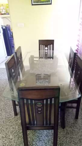 Glass top dinning six seater..