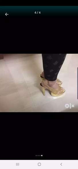 Golden high heel sandals