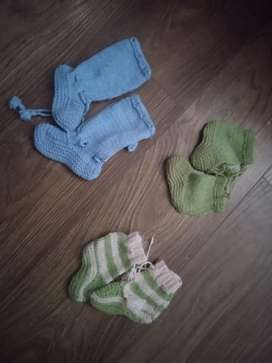 Newborn hand knitted socks sweaters caps