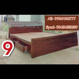 A brown color queen size cot with best wood and good quality