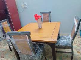 Wooden dining table n four chairs