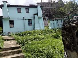 Land along with 2 old houses with sufficient water supply