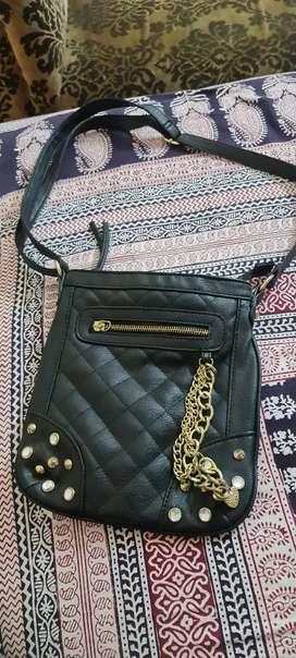 Claire's black sling bag