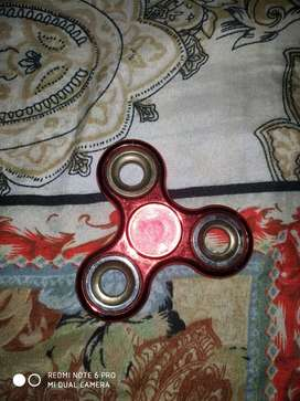 Spinner in red colour