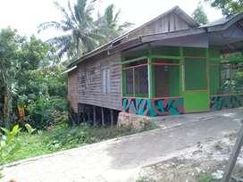 Rumah kayu dan tanah