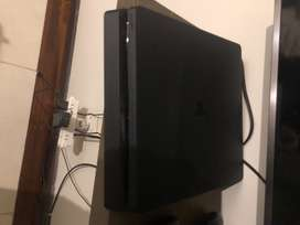 Ps4 Slim 1TB, two controllers, multiple games, barely used