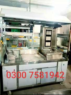 Shawarma counter with hot plate pizza oven fast food setup