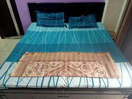 Double bed with mattress (1 yr old )for sale.. space issue 15k