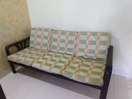 Wooden sofa with cushion cover