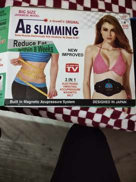 Ab slimming tones muscles electronically with vibrations