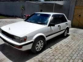toyota carolla 86 model good condition white colour kohat number