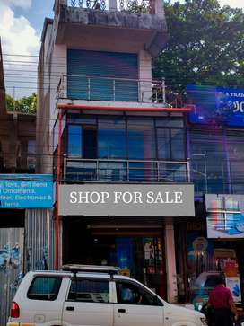 Shop for sale at anchal junction.fully furnished building.