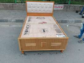 Designer single bed with cushion header available in NCR