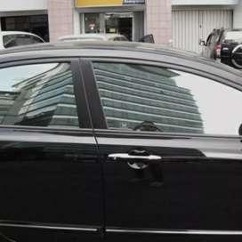 Kaca film pelindung panas dalam mobil