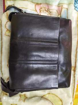 Rarely used and well maintained leather messenger bag