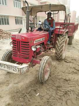 Tractor plus trolly in very good condition near you
