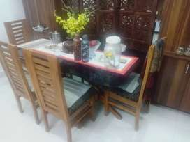Rectangle glass top teak wood dining table with four teak  chairs .