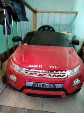 mobil aki merah