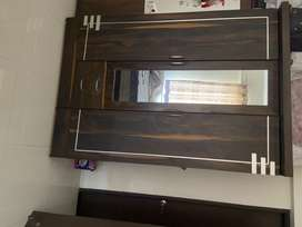 3 panel solid wood wardrobe. Comes with mirror  and lock.