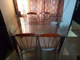 Four seater Glass Dining Table with Wood lining look