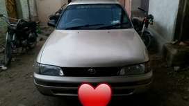 Toyota indus corolla 1999 make.Call at number given in the last photo.