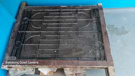 Window frame with grill