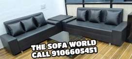 Great looking 3+2 seater black leather sofa with corner table