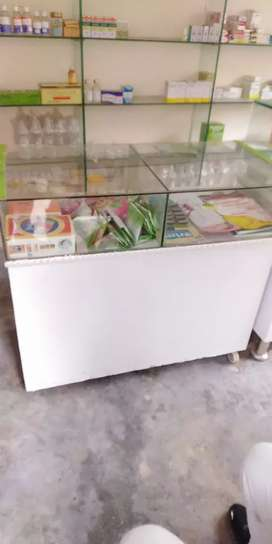 Shop glass counters and wall shelves