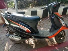 Cool orange-black scooty streak in affordable price.