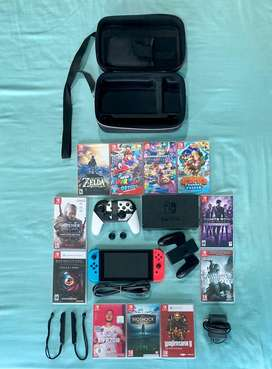 Nintendo switch V2 with travel case, games and Accessories