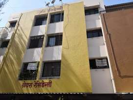 2BHK flat with fans and kitchen rack in Govind Nagar, family residence