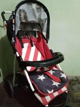 Stroller bayi bekas masih layak pakai